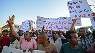 Protesters during a demonstration in Khartoum, 14 May 2019