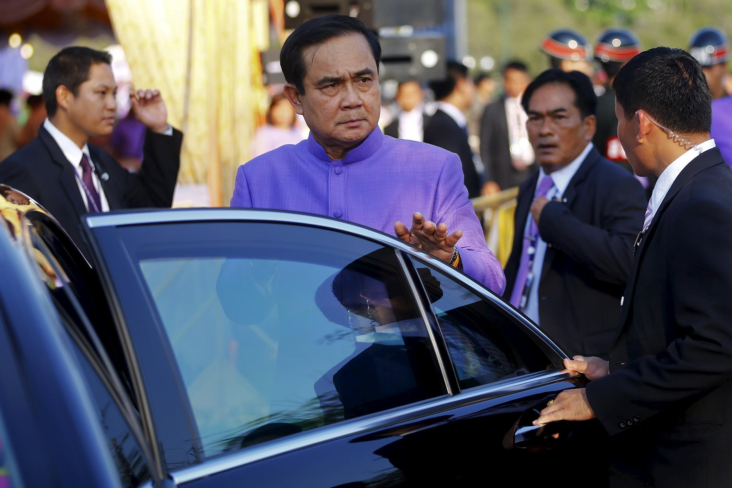 Thailand's Prime Minister Prayuth Chan-ocha gets in his car at Sanam Luang in Bangkok April 2, 2015, shortly after the lifting of martial law.