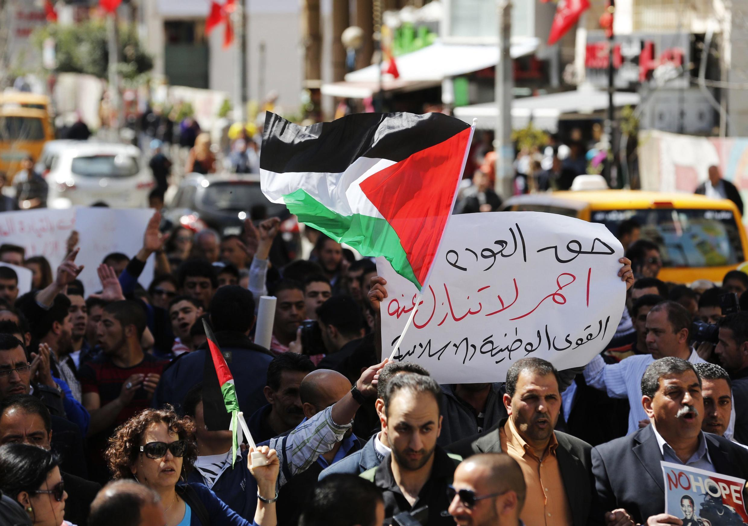 Palestinian protesters during a demonstration against U.S. President Barack Obama in Ramallah, 21 March, 2013