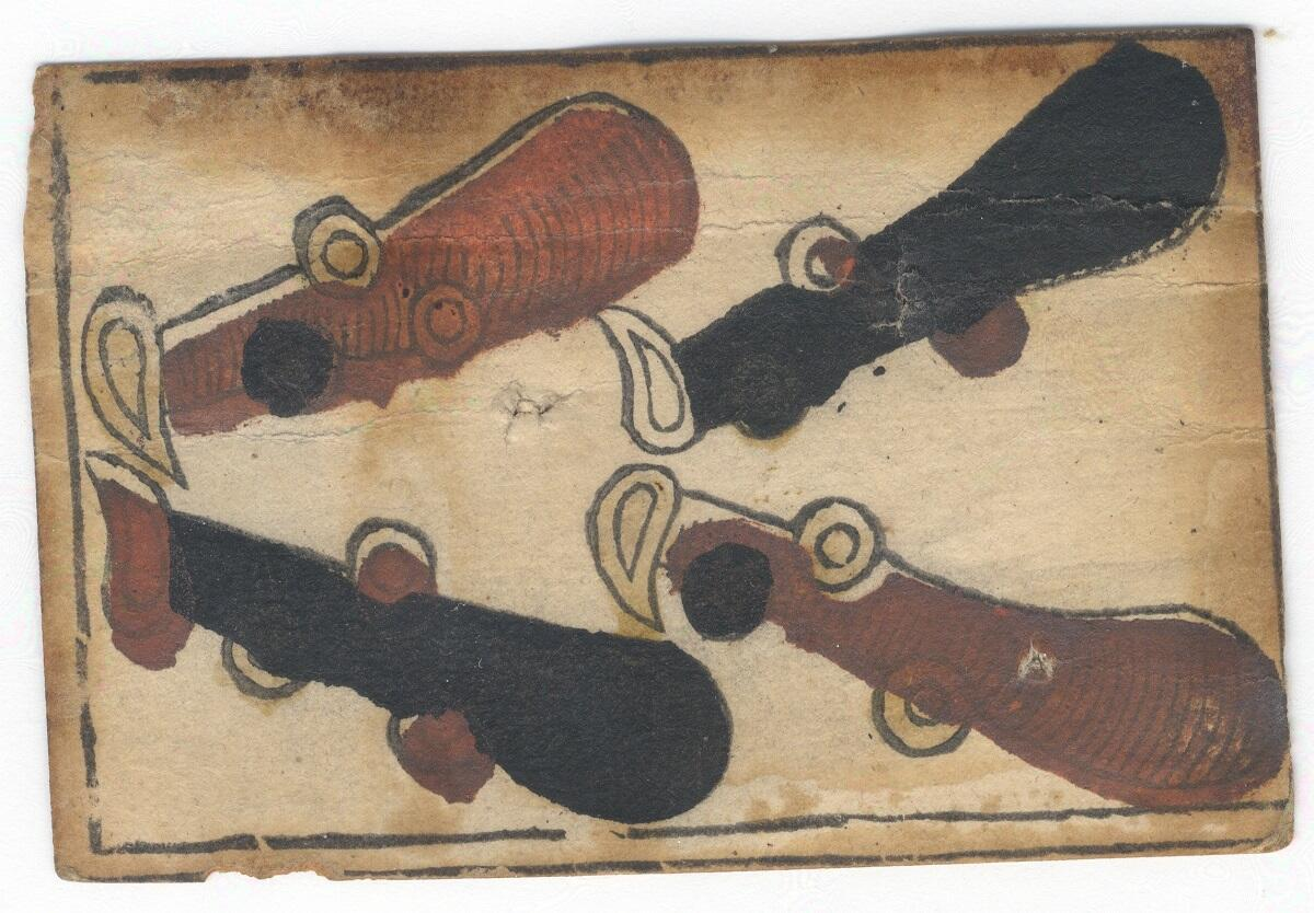 Hand drawn playing card, dating from 1739, designating the four of clubs. Playing cards were used as currency in Colonial New Orleans, as colonists would write IOUs on their reverse side.
