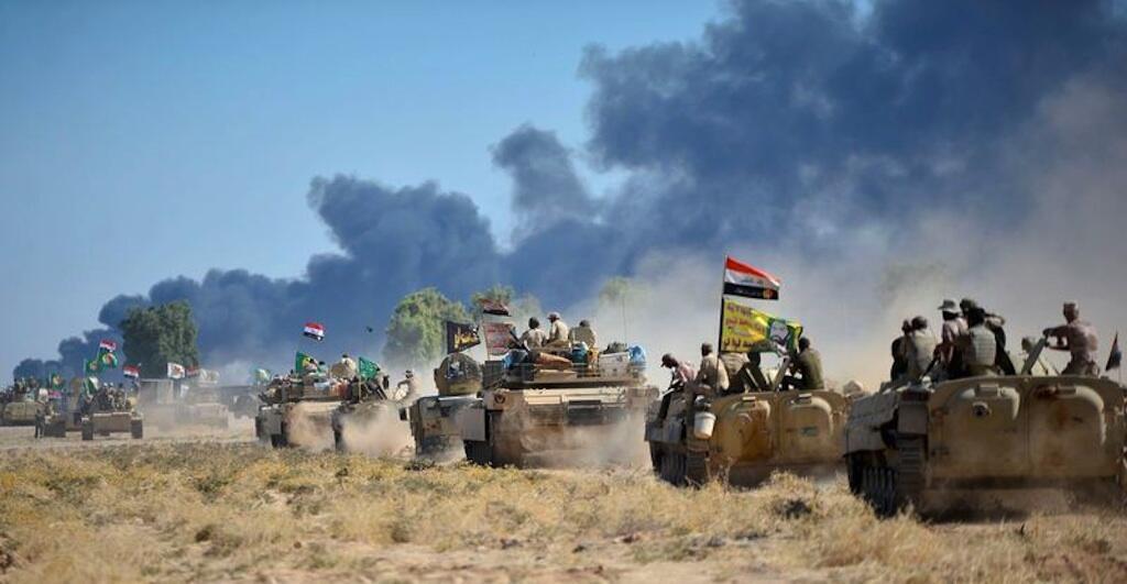 Wapiganaji wa Kamati za Uhamasishaji wa raia (CMP) na Jeshi la Syria karibu na mji wa Haouidja, Iraq.