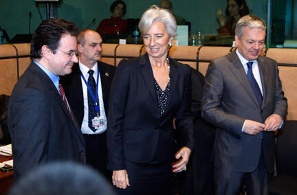 Greek Finance Minister George Papaconstantinou (L) with France's Christine Lagarde and Belgium's Didier Reynders