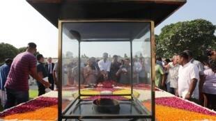 People pay homage at the Mahatma Gandhi memorial on 150th anniversary of his birth, Rajghat, New Delhi, 2 October 2019